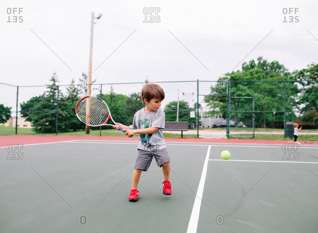 Boy practicing his tennis swing