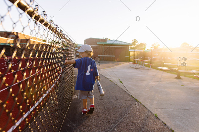 Young baseball player at a baseball field