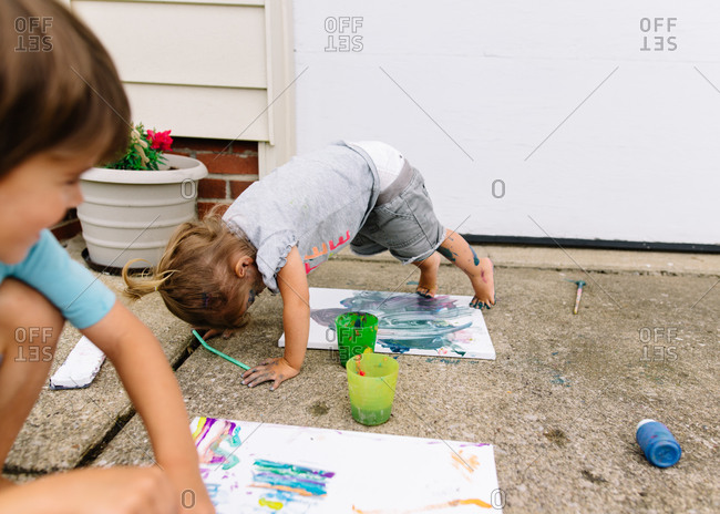 Kids having fun with paint outdoors