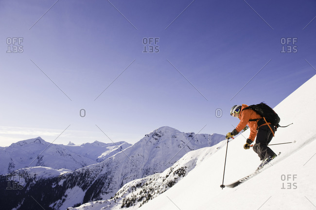 Downhill skier with backpack