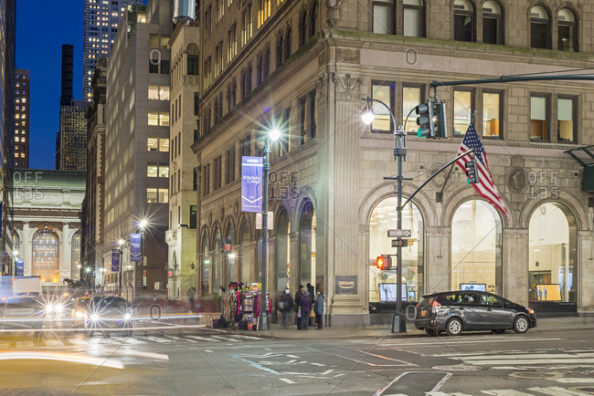 New York, USA - January 13, 2015: New York City street scene at night with Grand Central Terminal
