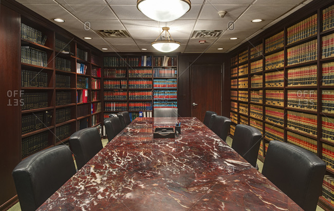 Inside a law library conference room with long marble table