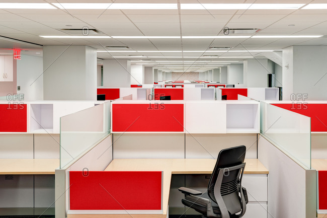 Office with red and white cubicles