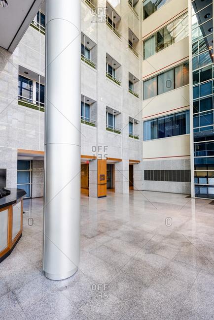 New York, USA - October 19, 2014: Inside the lobby atrium of an office building