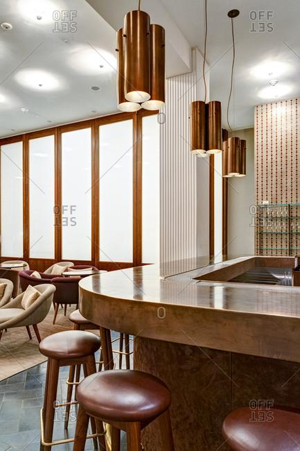 New York, USA - February 3, 2015: Stylish modern furnishings of a restaurant and bar space