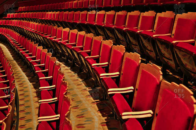 Albuquerque, New Mexico, USA - June 25, 2015: Rows of red seats at a theater