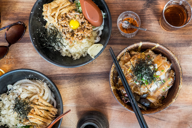 Bowls of katsudon and udon noodles