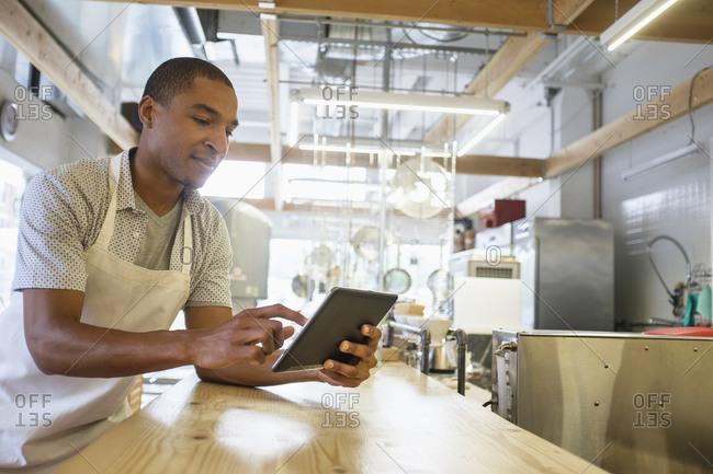 Bakery owner using digital tablet