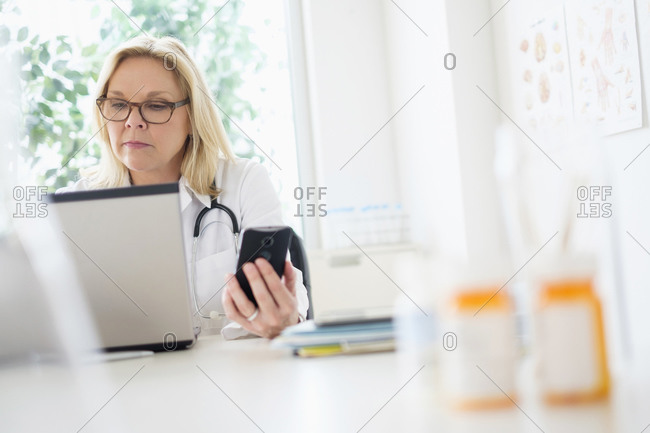 Doctor working with laptop in her office