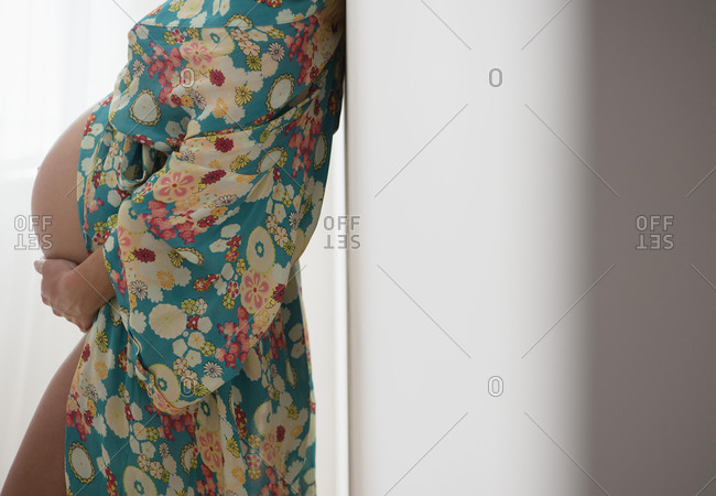 Pregnant woman in colorful dressing gown