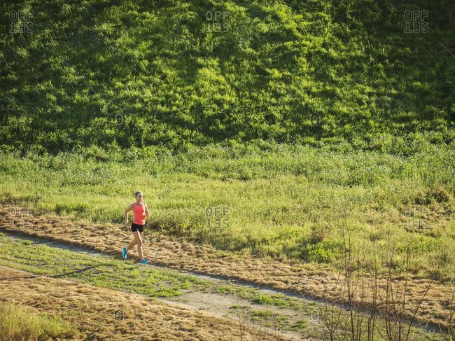 Woman running in field - Offset