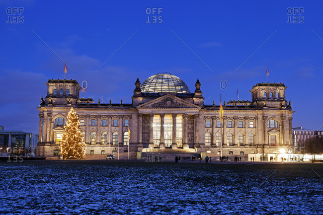 Berlin, Germany - December 28, 2014: Illuminated Bundestag building and snowy lawn