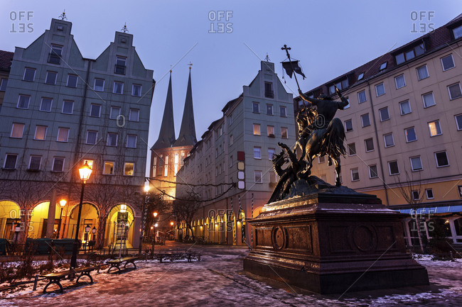 Equestrian statue on illuminated town square, Berlin