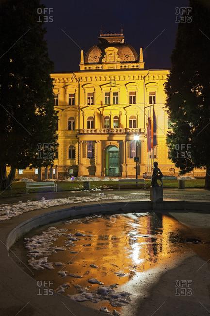 Maribor, Slovenia - February 12, 2015: Illuminated facade of Maribor University building , Slovenia