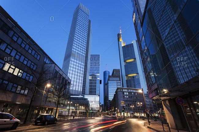 Frankfurt, Germany - January 4, 2015: Illuminated city street with skyscrapers