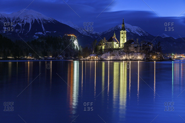 Lake Bled and illuminated Church of the Assumption, Bled