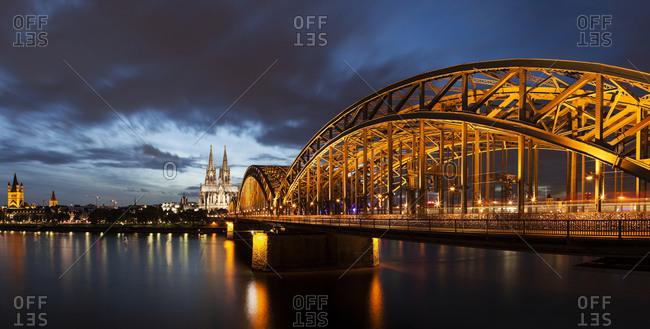 Hohenzollern Bridge illuminated at dusk, Cologne