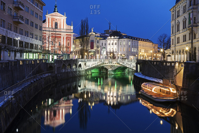 Illuminated buildings and Ljubljanica River