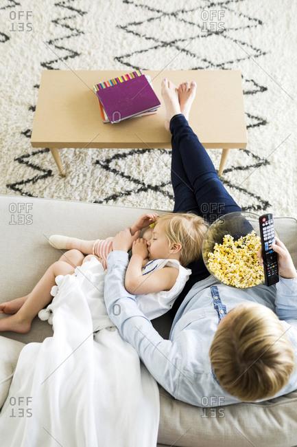 Girl sleeping on mom's lap