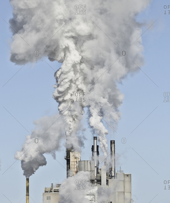 Smoke stacks emitting smoke