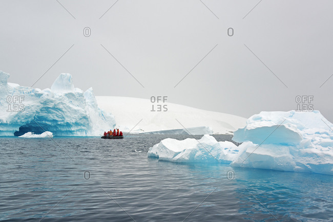Tour group crossing the ocean in the Antarctic in a rubber boat