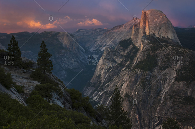 View of Half Dome in Yosemite Valley in Yosemite National Park California at dusk