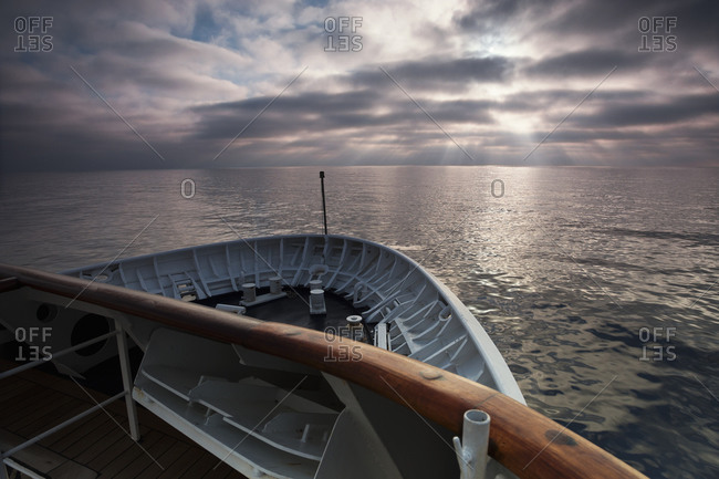 View across the ocean from the bow of a ship at dawn