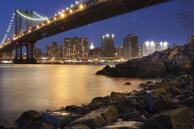 Night view towards Manhattan from Brooklyn with the Manhattan Bridge spanning the East River