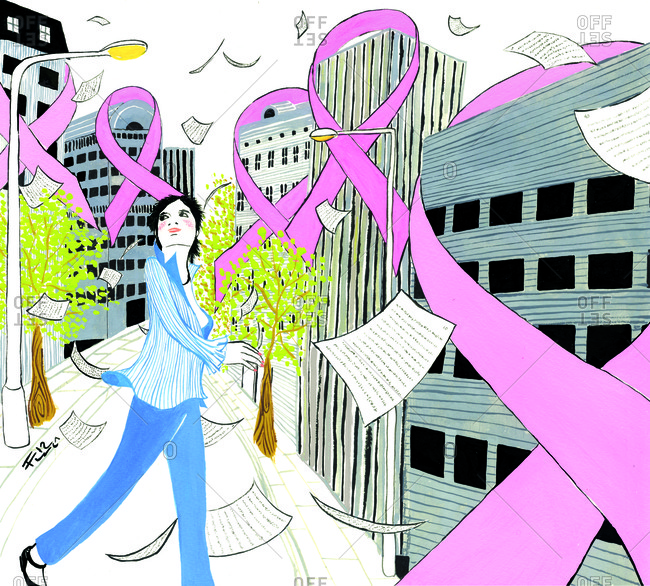 Urban woman walking amongst breast cancer ribbons