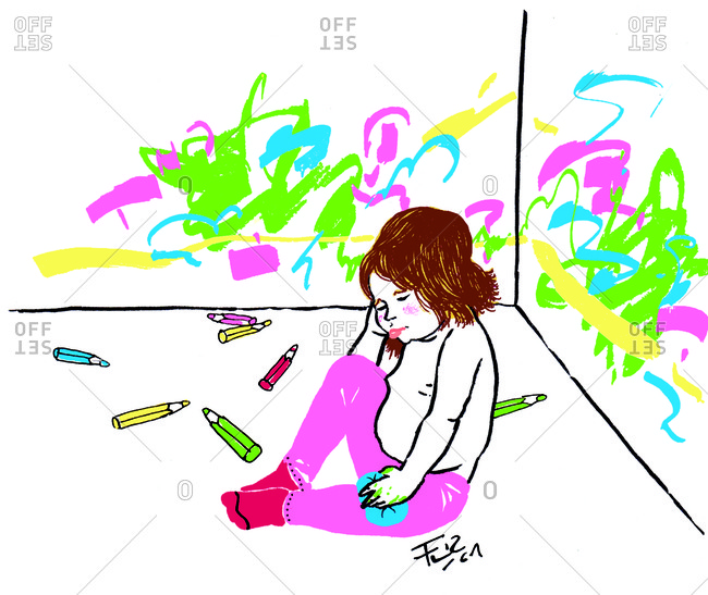 Little girl who has colored on the walls