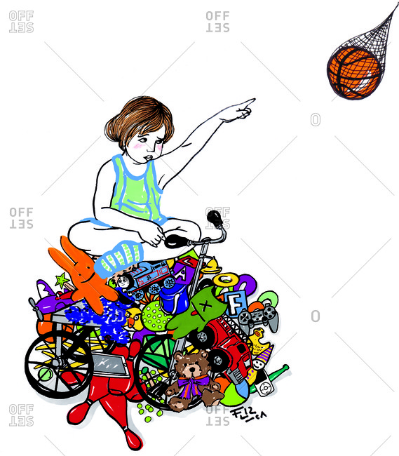 Child with many toys pointing to a basketball