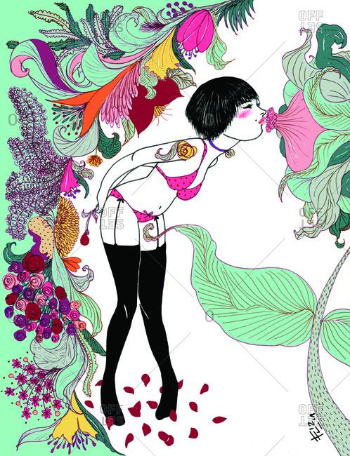Woman in lingerie kissing a flower