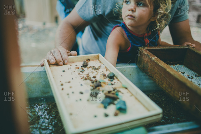 Young girl panning for gems