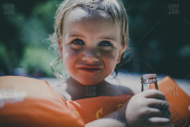 Close up of a child wearing a floatation device