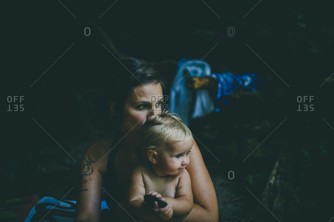 Mother holding her baby daughter outdoors
