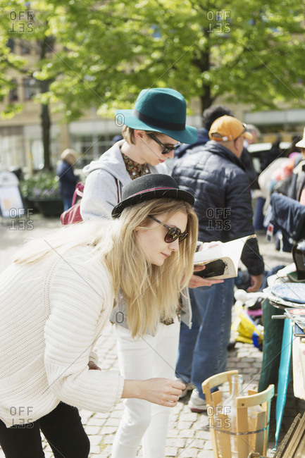Couple looking at items at an outdoor market