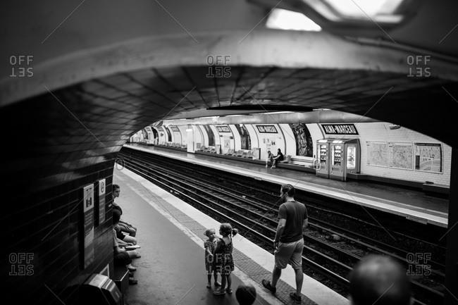 Paris, France - July 4, 2015: People waiting in Parisian subway