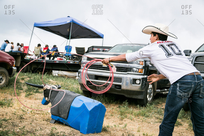 Taos, New Mexico, USA - June 28, 2015: Man practicing roping on a dummy bull