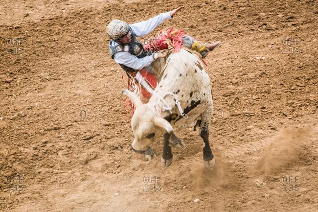 Taos, New Mexico, USA - June 28, 2015: Bull rider on a bucking bull