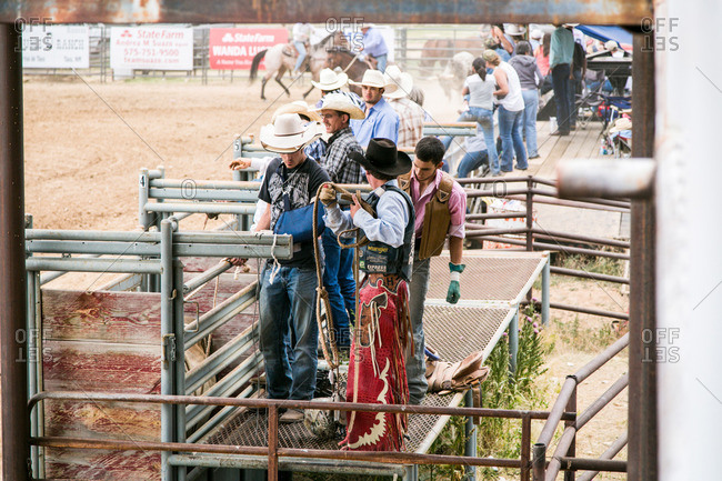 Taos, New Mexico, USA - June 28, 2015: Cowboys standing at a bull chute