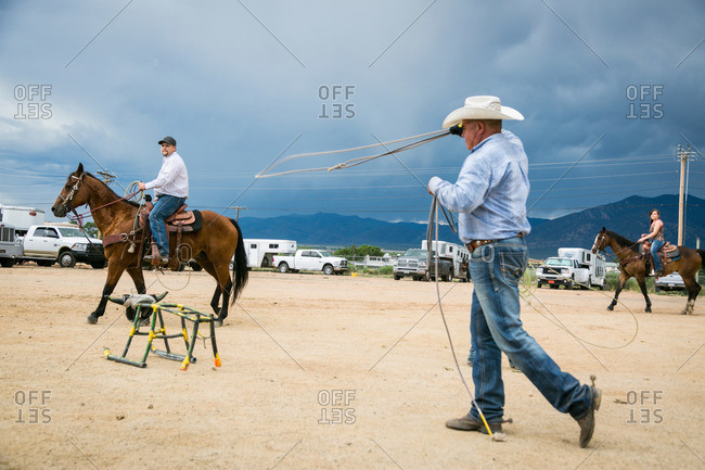 Taos, New Mexico, USA - June 28, 2015: Man practicing roping on a stationary bull