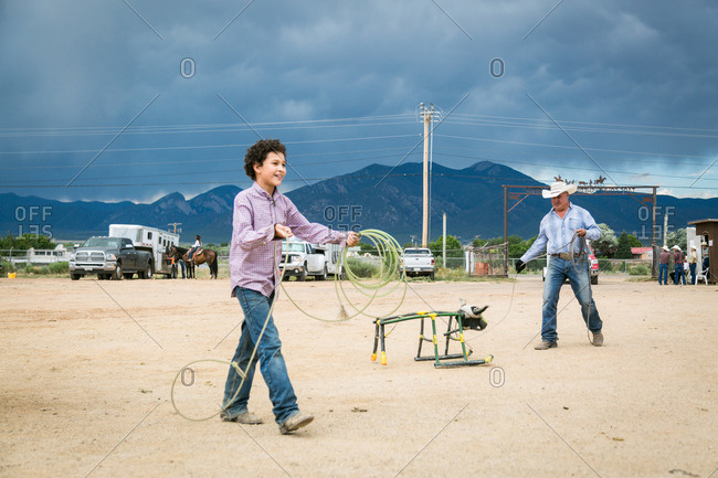 Taos, New Mexico, USA - June 28, 2015: Boy walking with rope for roping practice