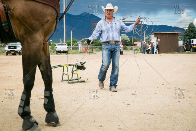 Taos, New Mexico, USA - June 28, 2015: Man with rope for bull roping practice