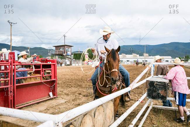 Taos, New Mexico, USA - June 28, 2015: Man on horseback with a lasso