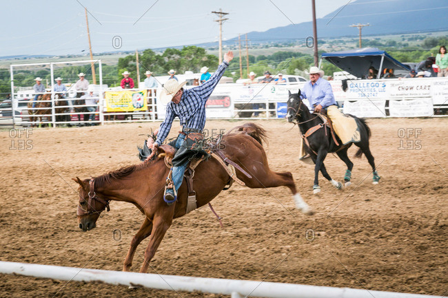 Taos, New Mexico, USA - June 28, 2015: Man riding a bucking bronco