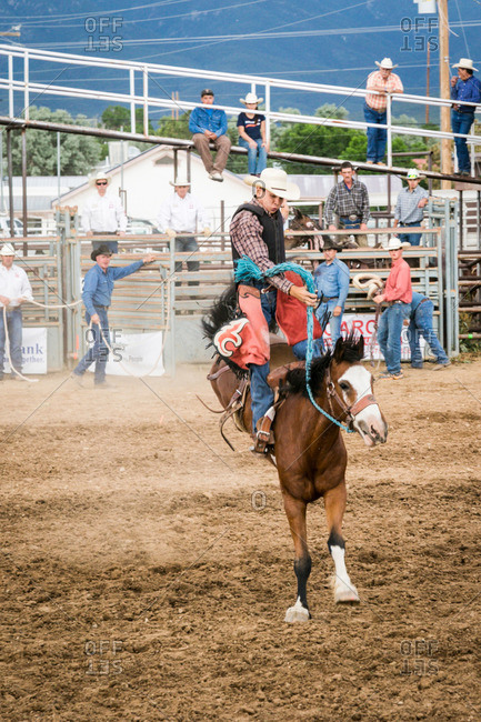 Taos, New Mexico, USA - June 28, 2015: Cowboy on a bucking bronco