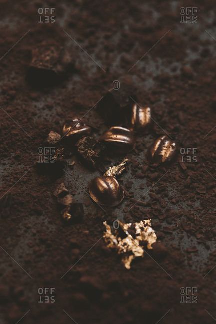Edible confection on chocolate scattered surface