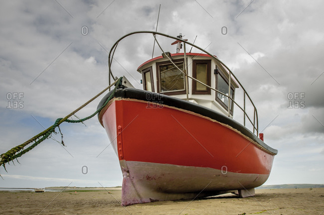 A fishing boat on a beach