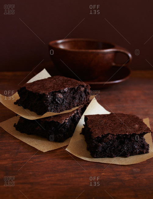 Three brownie slices on parchment paper
