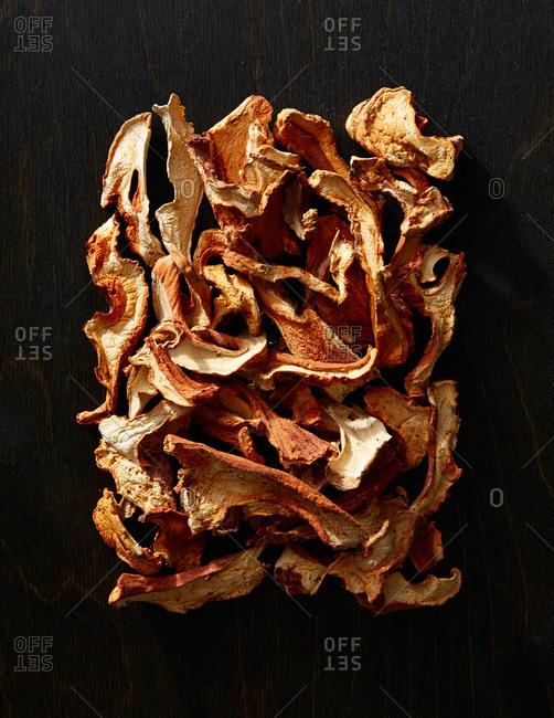 Dried lobster mushrooms on a dark background